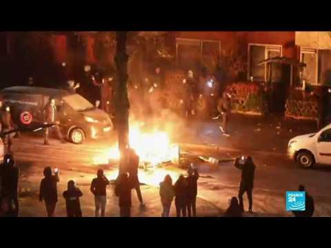 Dutch police use tear gas, water cannons after third night of violent riots against Covid-19 curfew
