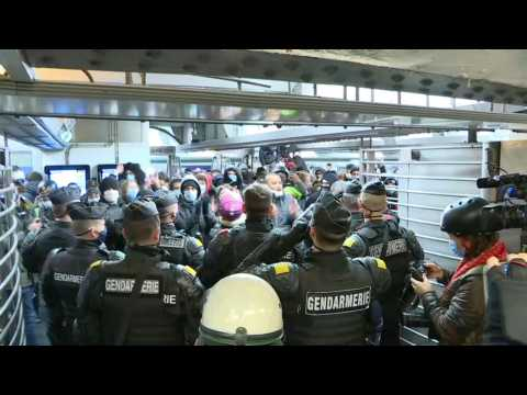 French security forces disperse protest against security bill in Paris