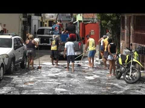 Manaus residents wash city's streets to fight Covid-19