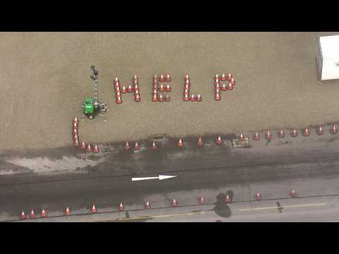 Stranded truckers at UK's Dover port spell out 'HELP' with traffic cones