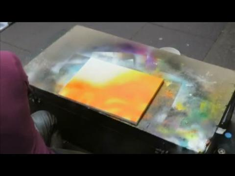 Edinburgh street artist creates spray-paint space painting using household items