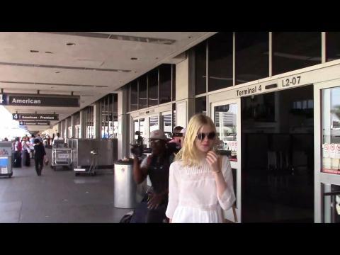 Elle Fanning Even Looks Glamorous When She Travels
