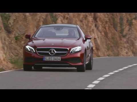 The new Mercedes-Benz E 220 d 4MATIC Coupe Driving Video in Hyacinth Red Metallic Trailer
