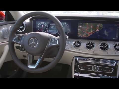 The new Mercedes-Benz E 220 d 4MATIC Coupe Interior Design in Hyacinth Red Metallic Trailer