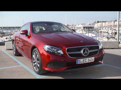 The new Mercedes-Benz E 220 d 4MATIC Coupe Exterior Design in Hyacinth Red Metallic Trailer