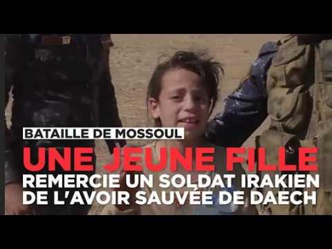 Une petite fille remercie un soldat irakien de l'avoir sauvée de Daech