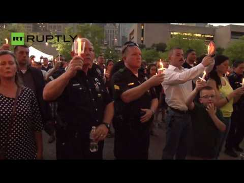 Hundreds Attend Vigil for Officers Killed by Dallas Sniper