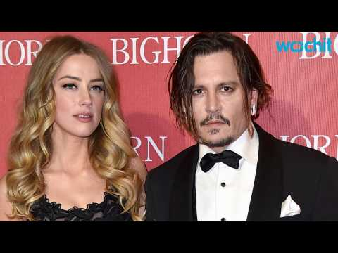 Amber Heard Thinks Johnny Depp Is Holding Up Their Divorce