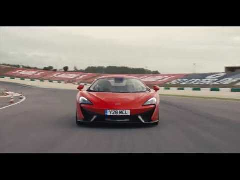 McLaren 570S Coupe - Vermillion Red Driving Video on the Track | AutoMotoTV