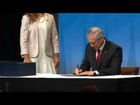 Pacific rim nations sign giant trade deal amid protests