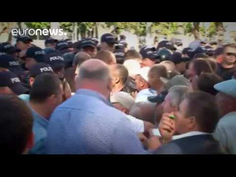 Protesters clash with police at Moldova independence day parade