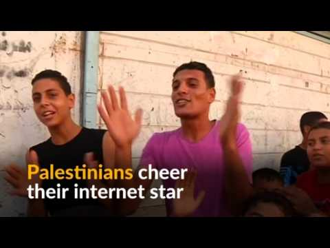 Palestinian internet sensation brings joy by singing about cats and trousers