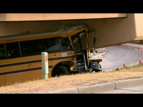 Police: 1 dead, up to 20 injured in Denver school bus crash
