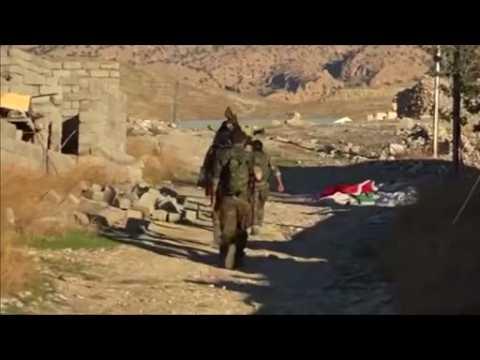 Kurdish militia join battle to retake Iraqi town