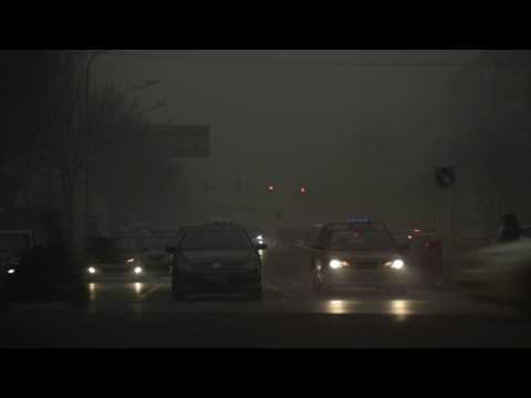 Beijing cloaked in smog as schools, factories close
