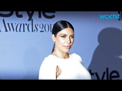 Pregnant Kim Kardashian Jokes While Standing Next to Models