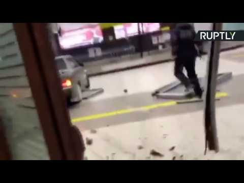 Driver Chased by Police Rams Through Glass Doors and Drives Into Airport