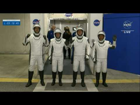 SpaceX team on their way to the Crew Dragon capsule