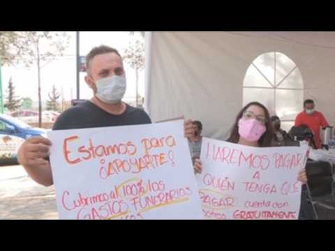 Relatives of Mexico metro overpass collapse victims search for justice