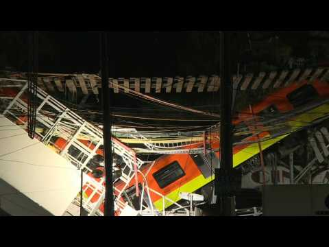 Mexico metro carriages hang from collapsed overpass
