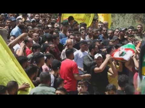Palestinians hold funeral for teenager shot dead by Israeli soldiers
