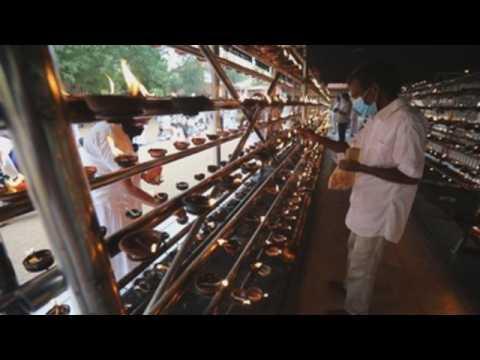 Buddhist devotees take part in observances on full moon day in Sri Lanka
