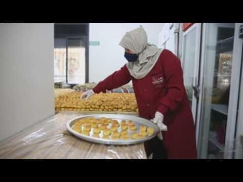 Palestinian women make sweets ahead of the end of Ramadan