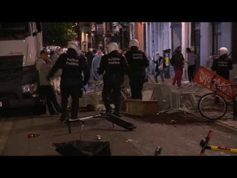 Police in Brussels break up crowds of people celebrating the end of curfew