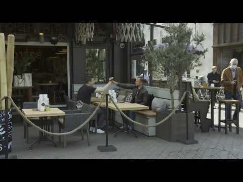 Netherlands: cafes start serving outdoors again in The Hague, as Covid curfew lifted