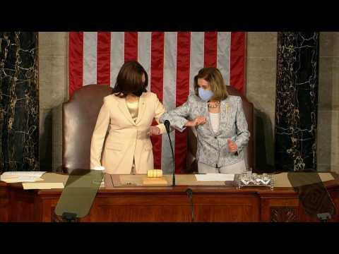 Vice President Kamala Harris greets Speaker Pelosi with an elbow bump