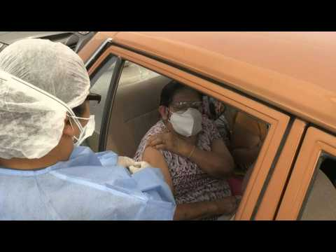 Peruvians receive Covid-19 vaccine as LATAM nears 1 million death toll