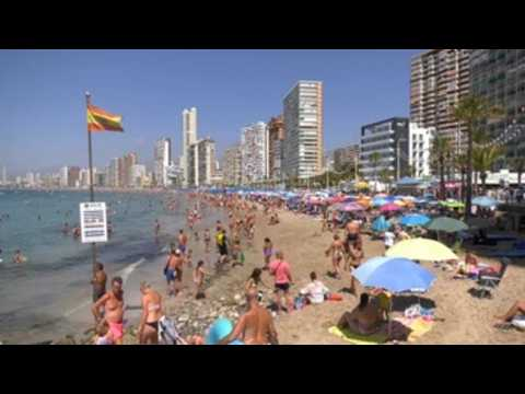 Holidaymakers enjoy beach in Benidorm