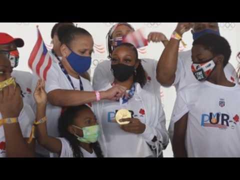 Camacho-Quinn arrives in Puerto Rico, leads caravan wearing Olympic gold