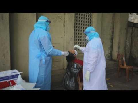 Sri Lankan health workers perform Covid-19 swab tests in Colombo