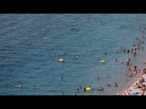 Holidaymakers in Nice head to beach to cool down