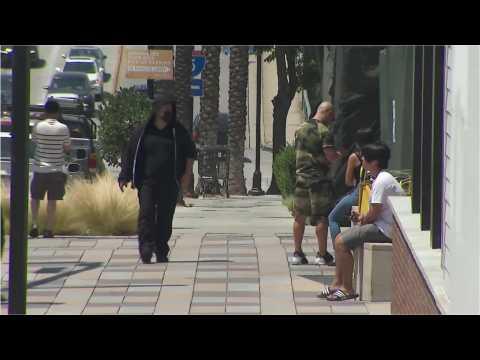 People in Burbank, California wear masks despite covid-19 regulations easing