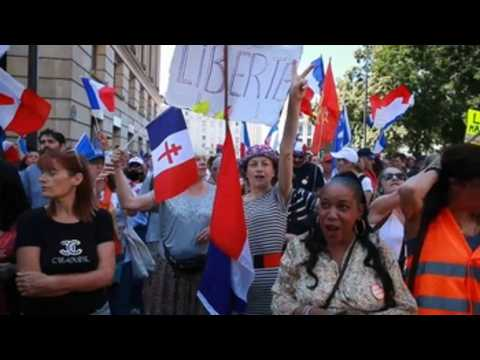 Thousands protest in France against health pass