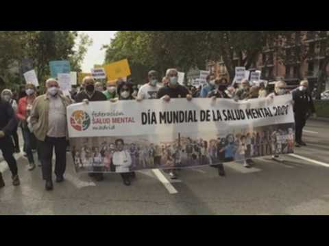 People march in Madrid to mark World Mental Health Day