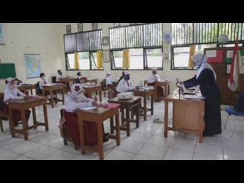 Indonesian students return to schools as gov't starts easing COVID-19 restrictions