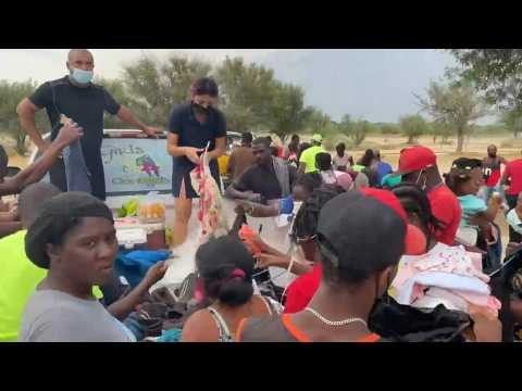 Food and clothes distributed to Haitian migrants encamped on US-Mexico border
