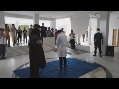 Authorities in Aceh carry out public punishment under Sharia Law