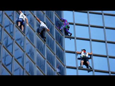 'French Spider-Man' climbs Paris tower to protest COVID health pass