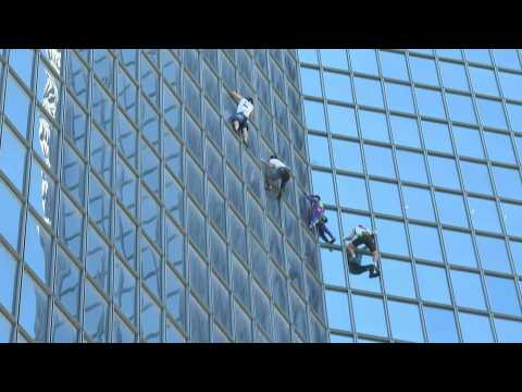 'Spider-man' scales skyscraper in protest at French Covid pass