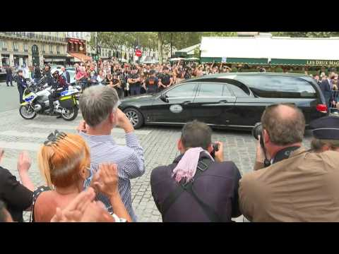 Hearse carrying late French actor Belmondo departs after ceremony