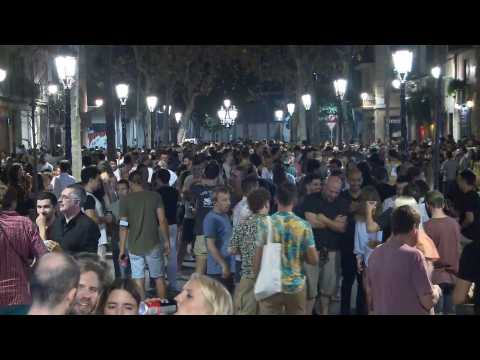 Crowds gather to drink in streets of Barcelona amid pandemic