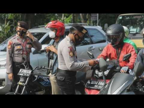 Indonesia tightens restrictions amid rising COVID-19 cases