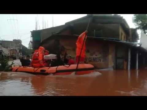 People rescued after deadly flooding in India