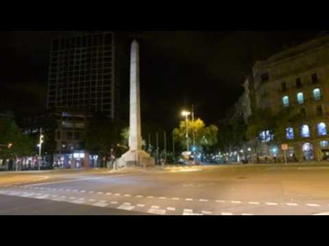 The streets of Barcelona are empty once again at night after a new curfew