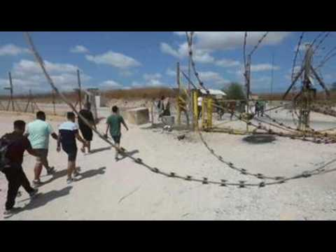 Palestinians cross Israeli separation barrier during Eid al-Adha