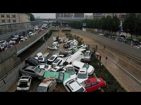 Flood aftermath: Pile up of cars on road in China